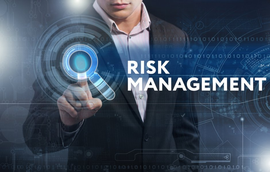 risk management text with a man in the background